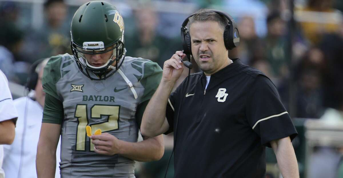 Baylor head football coach Matt Rhule, right, looks on with quarterback Charlie Brewer during their match up with Iowa State in the second half of an NCAA college football game, Saturday, Nov. 18, 2017, in Waco, Texas. Iowa State won 23-13. (Rod Aydelotte/Waco Tribune-Herald via AP)