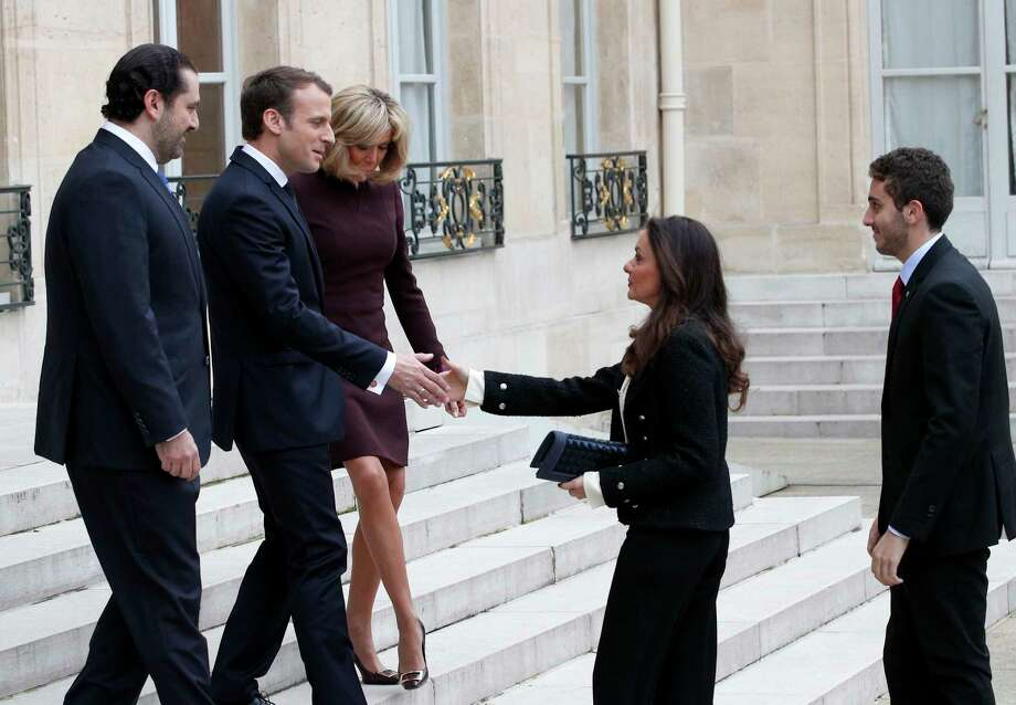 French President Emmanuel Macron, second left, and his wife Brigitte, centre left, greet Lebanon's Prime Minister Saad Hariri, left, his wife Lara, center center and their son Hussam, right, upon their arrival at the Elysee Palace in Paris, Saturday, Nov. 18, 2017. Hariri arrived in France on Saturday from Saudi Arabia and may be back in Beirut next week, seeking to dispel fears that he had been held against his will and forced to resign by Saudi authorities.(AP Photo/Christophe Ena) Photo: Christophe Ena, STF / Copyright 2017 The Associated Press. All rights reserved.
