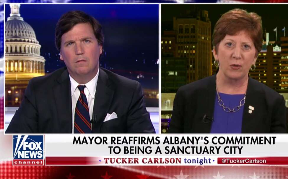 Fox News host Tucker Carlson gives Albany Mayor Kathy Sheehan his patented confused face as she discusses sanctuary cities Thursday. (screenshot)
