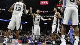 Forward LaMarcus Aldridge (12) and guard Danny Green (center) have shouldered the leadership burden with Kawhi Leonard and Tony Parker sidelined with injuries.