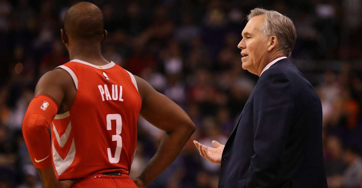 PHOENIX, AZ - NOVEMBER 16: Head coach Mike D'Antoni of the Houston Rockets talks with Chris Paul #3 during the second half of the NBA game against the Phoenix Suns at Talking Stick Resort Arena on November 16, 2017 in Phoenix, Arizona. The Rockets defeated the Suns 142-116. NOTE TO USER: User expressly acknowledges and agrees that, by downloading and or using this photograph, User is consenting to the terms and conditions of the Getty Images License Agreement. (Photo by Christian Petersen/Getty Images)