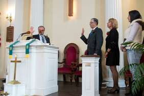 Former East Haven attorney Lawrence Sgrignari administered the oath of office to Mayor Joseph Maturo, Jr. Saturday as his wife, Karen, and daughter Jamie look on.