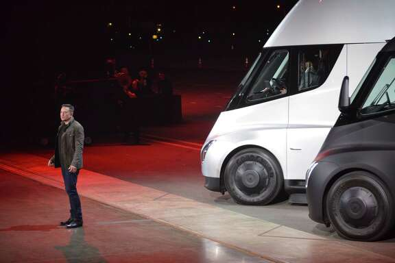 "Tesla Chairman and CEO Elon Musk unveils the new ""Semi"" electric Truck for buyers and journalists on Nov. 16, 2017, in Hawthorne, Calif., near Los Angeles.  (AFP/Getty Images)"