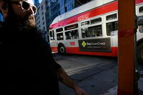 Above: A 5R-Fulton bus carries an advertisement for the Green Cross medical marijuana dispensary. Below: An advertisement on the side of a Muni bus downtown touts the Urban Pharm dispensary.