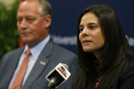 UTSA's new athletics director Lisa Campos speaks during a press conference held Friday Nov. 17, 2017 at the campus. UTSA president Taylor Eighmy is pictured in background.