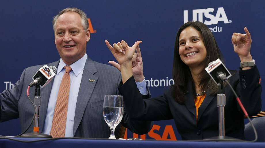 "UTSA president Taylor Eighmy (left) and new athletics director Lisa Campos gesture the ""Birds Up"" during a press conference last November. Photo: Edward A. Ornelas /San Antonio Express-News / © 2017 San Antonio Express-News"