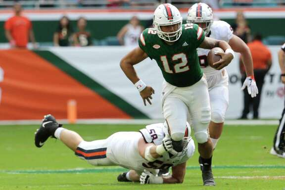 Miami quarterback Malik Rosier gets away from  Virginia defensive end Eli Hanback.