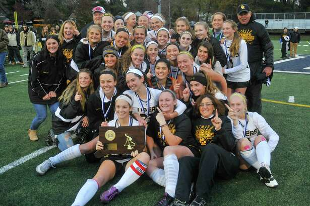 The Daniel Hand Tigers celebrate a victory of the CIAC Class M Field Hockey Final against the New Canaan Rams at Weathersfield High School on Saturday November 18, 2017 in Weathersfield, Connecticut.