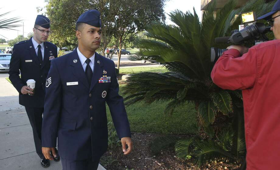 Air Force Staff Sgt. Luis Walker, left foreground,  arrives for the fourth day of his trial at Lackland Air Force Base in San Antonio, Texas, Friday, July 20, 2012. Walker is accused of sexually assaulting 10 basic trainees, with charges ranging from rape and aggravated sexual assault to obstructing justice and violating rules of professional conduct. If convicted, he could be sentenced to life imprisonment.   (AP Photo/San Antonio Express News, Billy Calzada) Photo: Billy Calzada, MBO / AP / Associated Press