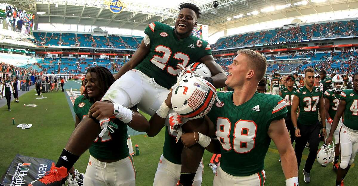 MIAMI GARDENS, FL - NOVEMBER 18: Christopher Herndon IV #23 of the Miami Hurricanes is carried off the field after winning a game against the Virginia Cavaliers at Hard Rock Stadium on November 18, 2017 in Miami Gardens, Florida. (Photo by Mike Ehrmann/Getty Images)