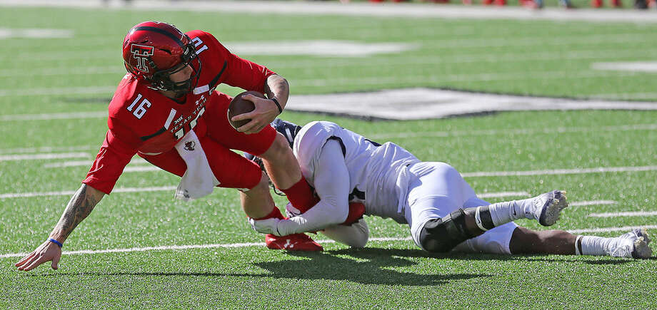 Texas Tech quarterback Nic Shimonek (16) is sacked by TCU defensive back Ridwan Issahaku (31) in Saturday's Big 12 matchup in Lubbock at Jones AT&T Stadium. (Photo by Wade H. Clay | Special to the MRT)