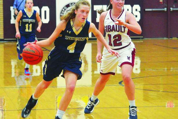 Father McGivney freshman Anna McKee, left, drives to the basket during Saturday's championship game against Waterloo Gibault at the Dupo Cat Classic.
