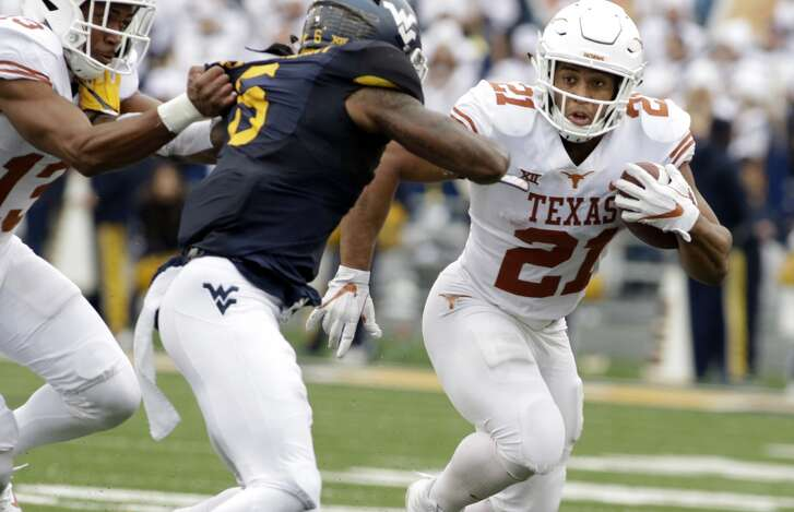 West Virginia safety Dravon Askew-Henry (6) moves to tackle Texas running back Kyle Porter (21) during the second half of an NCAA college football game, Saturday, Nov. 18, 2017, in Morgantown, W.Va. Texas defeated West Virginia 28-14. (AP Photo/Raymond Thompson)
