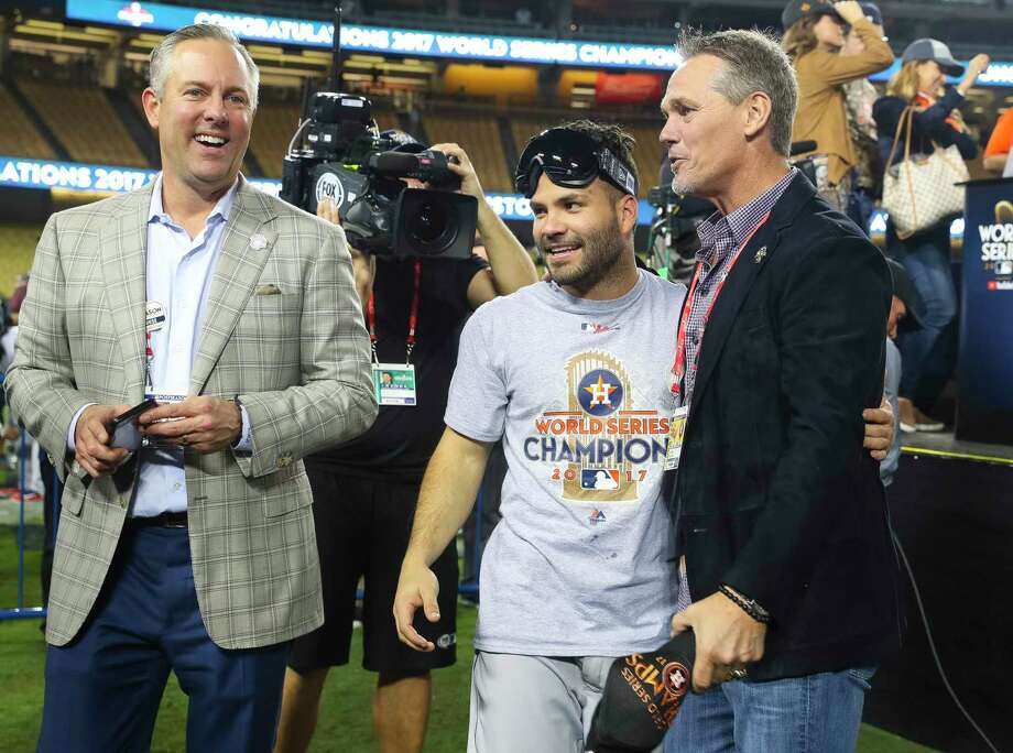 Two Astros second basemen celebrate a title. Jose Altuve, left, has a World Series crown; Craig Biggio, right, is a Hall of Famer. Photo: Michael Ciaglo, Houston Chronicle / © 2017 Houston Chronicle