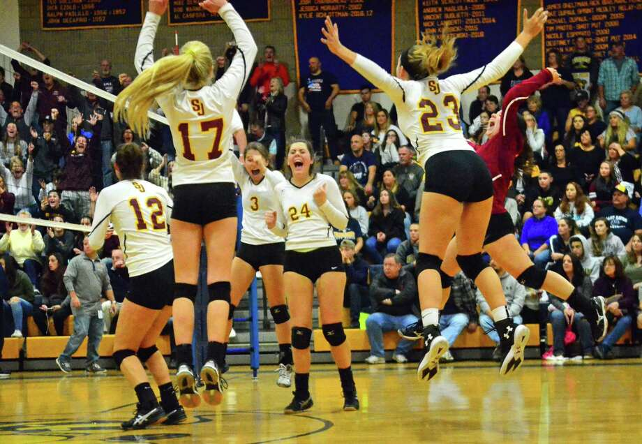 St. Joseph celebrates its win over East Haven in Class M volleyball finals action in East Haven, Conn. on Saturday Nov. 18, 2017. Photo: Christian Abraham / Hearst Connecticut Media / Connecticut Post