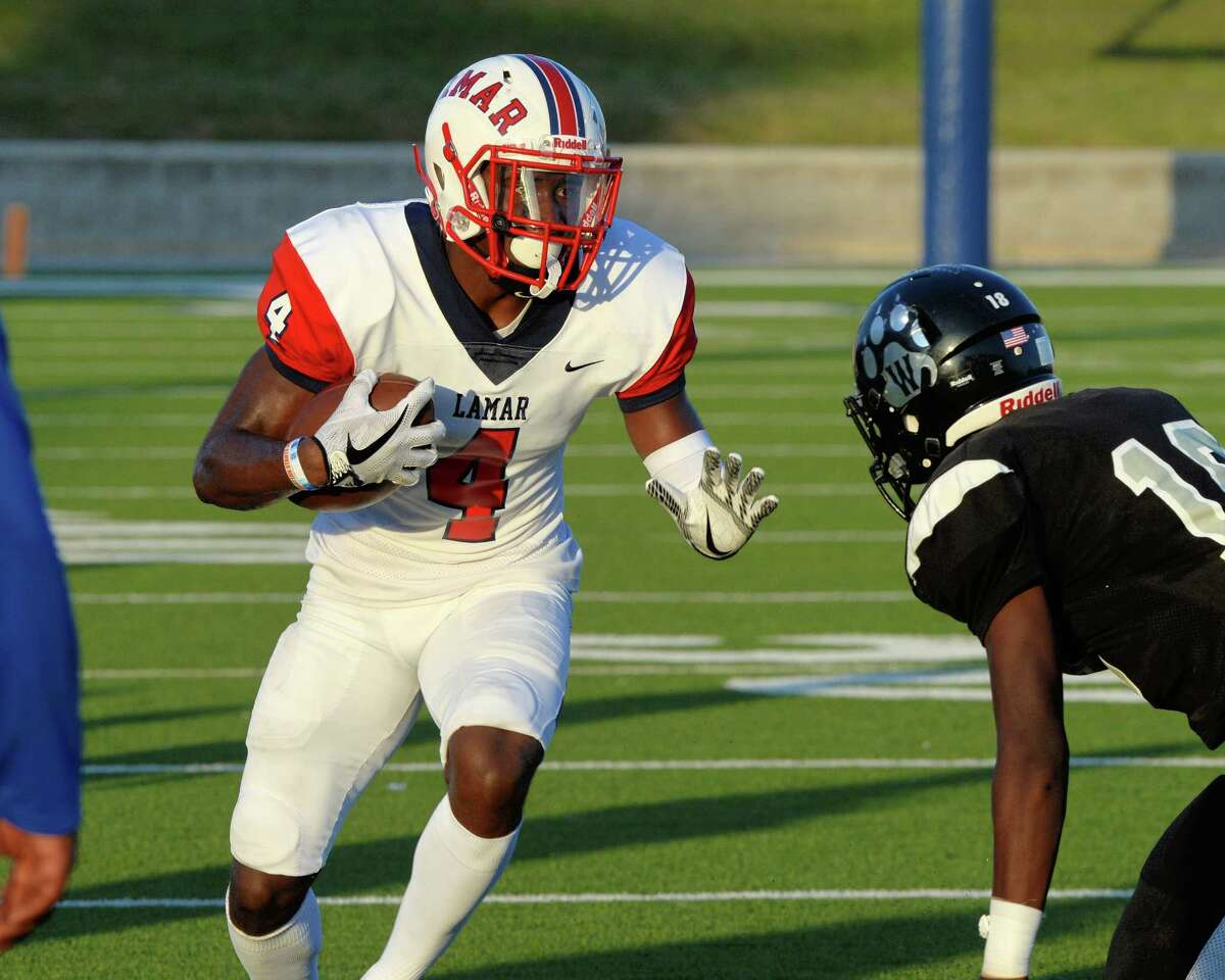 Al'Vonte Woodard (4) of Lamar makes a reception and carries for a first down in the first quarter of a high school football game between the Lamar Texans and the Westside Wolves on October 7, 2017 at Delmar Stadium, Houston, TX.