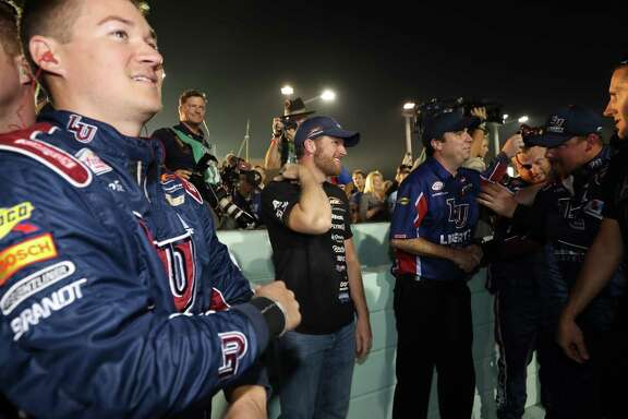 William Byron, left, put a smile on part owner Dale Earnhardt Jr.'s face by winning the Xifinity Series title on Saturday.