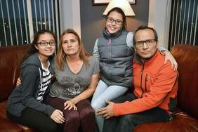 Miriam Martinez, 53, a Stamford mother facing deportation to Guatemala with her husband Raphael Benavides, 46, and their daughters Brianna Benavides, 12, at left, and her 10-year-old sister Allison Benavides are photographed, Saturday at the New Haven office of their attorney, Glenn Formica.