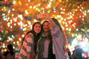Tracy Nguyen (from left),Talitha Johnson, and Macy Suplick pose for a selfie during the University of the Incarnate Word's 31st annual Light the Way event held Saturday Nov. 18, 2017 at the campus.