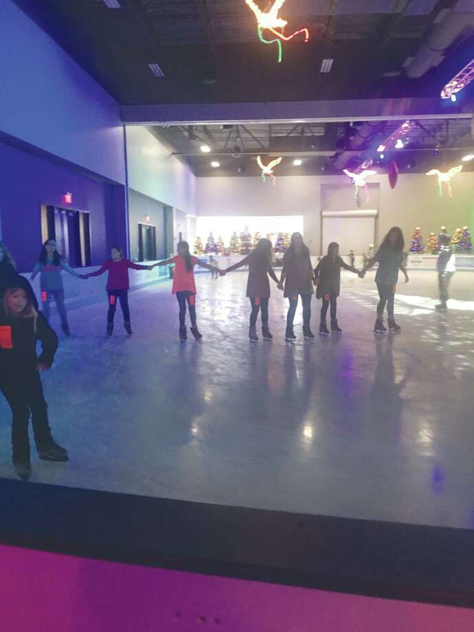 Skaters do laps around the rink during the opening day of theThe Ice Rinklocated at The Cynthia Woods Mitchell Pavilion multi-purpose building. Photo: Patricia Dillon