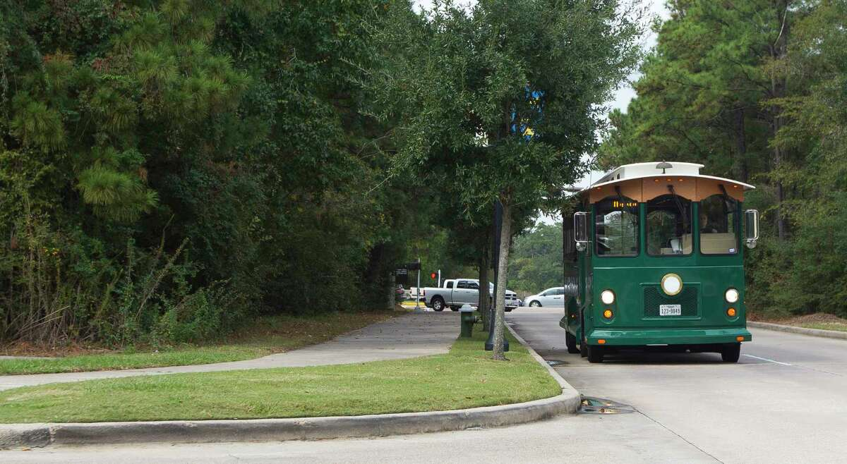 A trolley with The Woodlands trolley system is seen along Lake Woodlands Drive, Thursday, Nov. 16, 2017.