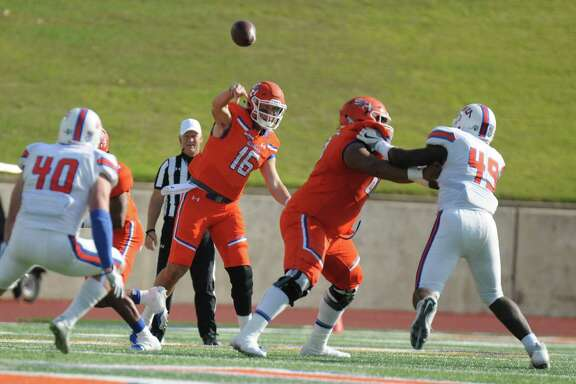 Sam Houston State quarterback Jeremiah Briscoe, left, threw for 464 yards and five touchdowns as he surpassed 10,000 career passing yards in the Bearkats' 53-33 victory over HBU on Saturday at Bowers Stadium.