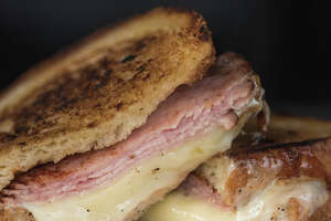 """A smoked ham, sharp white cheddar and horseradish BBQ sauce sandwich by The Cheese Pit called the """"The Sweet Baby Ray's, photographed during the Grilled Cheese Grand Prix at Magnuson Park on Saturday, Nov. 18, 2017."""