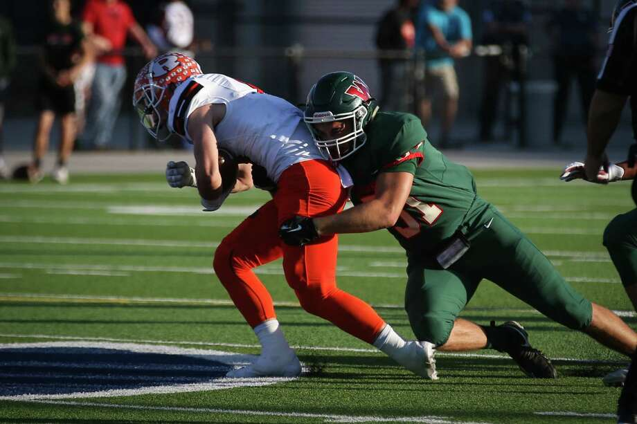 The Woodlands' Joey Russo (51) tackles Rockwall's Zach Henry (6) during the varsity football game on Friday,  Nov. 17, 2017, at Woodforest Bank Stadium. (Michael Minasi / Houston Chronicle) Photo: Michael Minasi, Staff Photographer / © 2017 Houston Chronicle