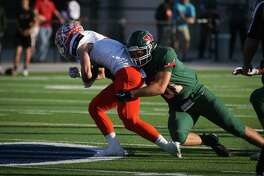 The Woodlands' Joey Russo (51) tackles Rockwall's Zach Henry (6) during the varsity football game on Friday,  Nov. 17, 2017, at Woodforest Bank Stadium. (Michael Minasi / Houston Chronicle)