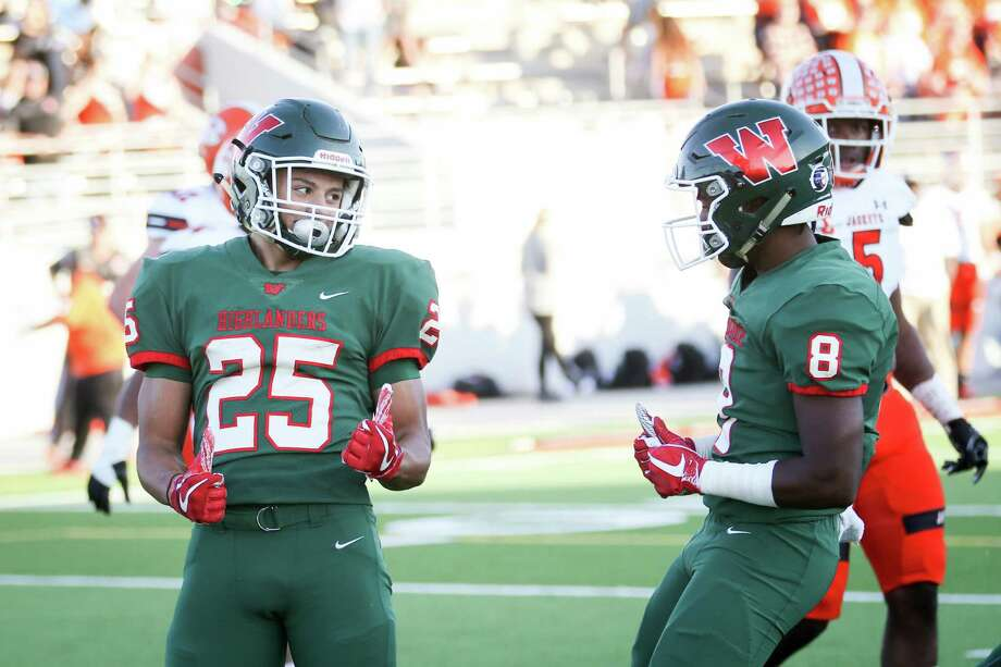 The Woodlands' Bryeton Gilford (25) celebrates with Malik Johnson (8) after scoring a touchdown during the varsity football game on Friday,  Nov. 17, 2017, at Woodforest Bank Stadium. (Michael Minasi / Houston Chronicle) Photo: Michael Minasi, Staff Photographer / © 2017 Houston Chronicle