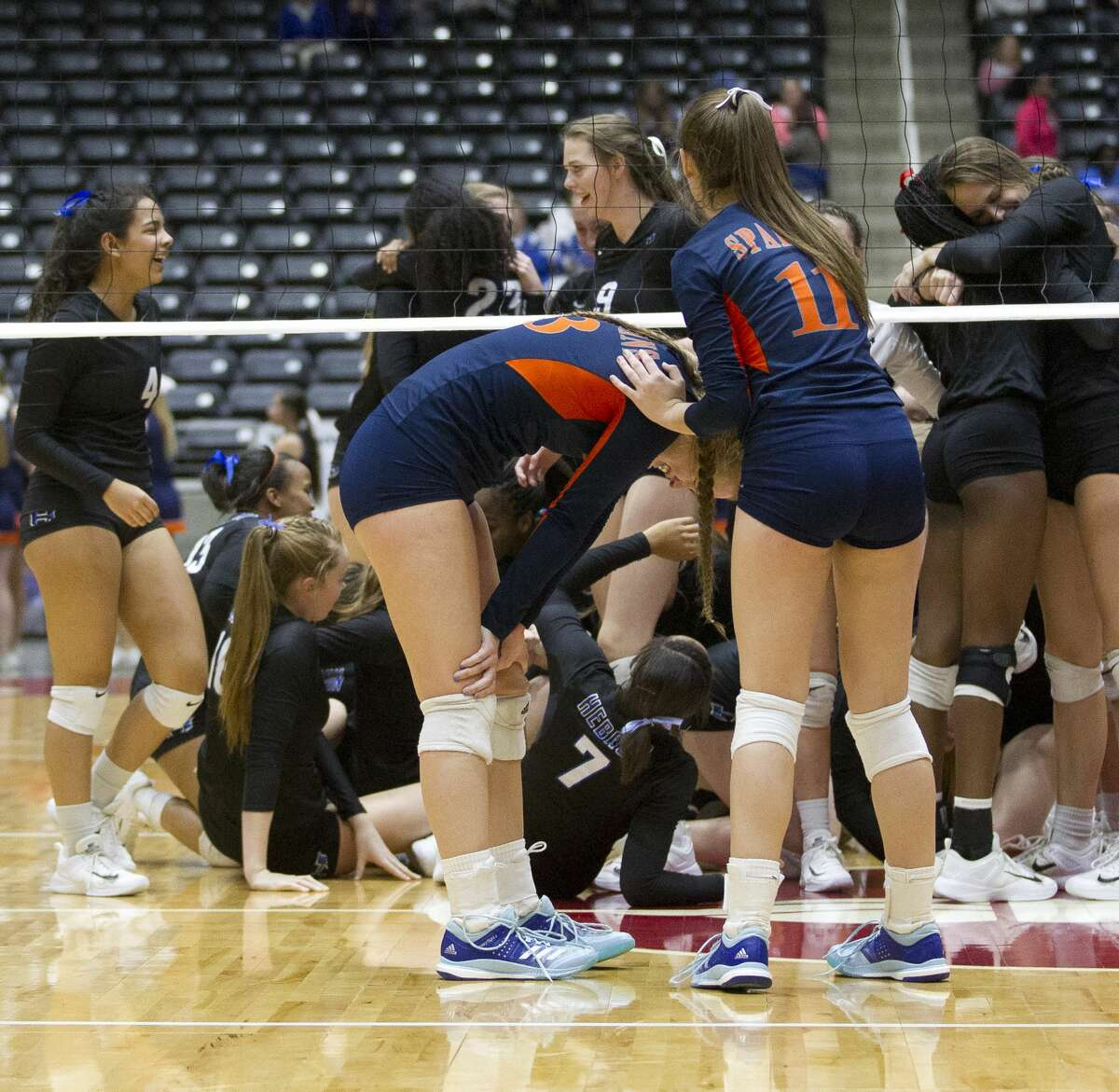 Katy Seven Lakes players react after being swept in straight sets by Lewisville Hebron in the Class 6A state championship at the Curtis Culwell Center, Saturday, Nov. 18, 2017, in Garland.