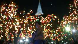 Johnny Trevino and his son Jax, 2, take in the sights during the University of the Incarnate WordÕs 31st annual Light the Way event held Saturday Nov. 18, 2017 at the campus.