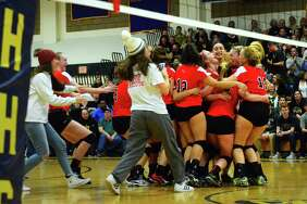 Greenwich celebrates its win over Amity during Class LL volleyball finals action in East Haven, Conn. on Saturday Nov. 18, 2017.