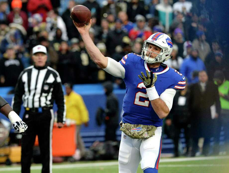 FILE-This Nov. 12, 2017, file photo shows Buffalo Bills quarterback Nathan Peterman (2) throwing from the pocket during the second half of an NFL football game against the New Orleans Saints, in Orchard Park, N.Y.  Peterman will make his first NFL start this weekend when the Bills attempt to snap their two-game losing streak against the Los Angeles Chargers. (AP Photo/Adrian Kraus, File) ORG XMIT: NYSH905 Photo: Adrian Kraus / FR171451 AP