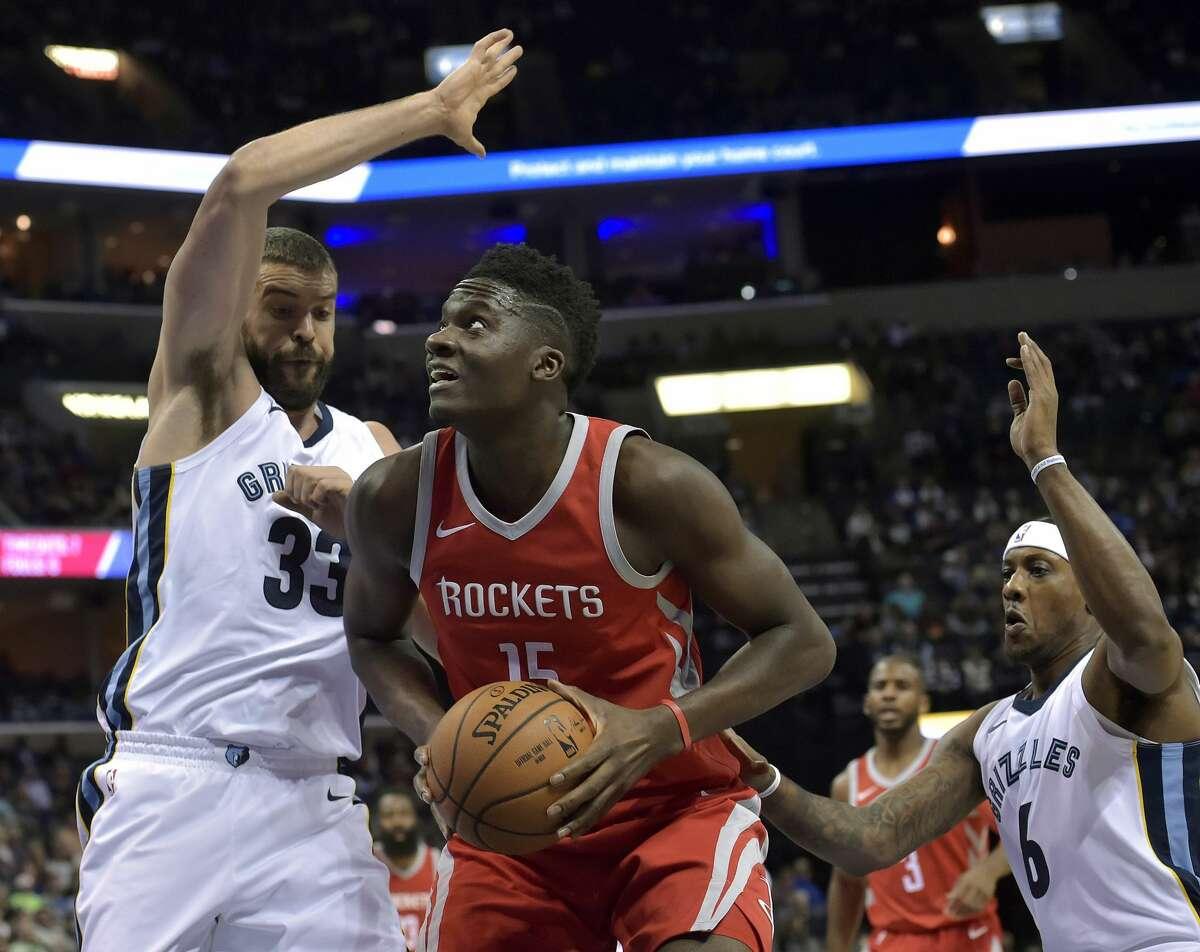 Houston Rockets center Clint Capela (15) drives between Memphis Grizzlies center Marc Gasol (33) and guard Mario Chalmers (6) during the first half of an NBA basketball game Saturday, Nov. 18, 2017, in Memphis, Tenn. (AP Photo/Brandon Dill)