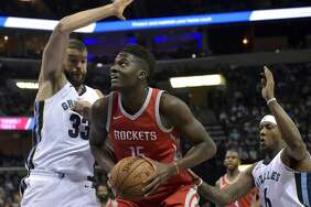 Houston Rockets center Clint Capela (15) drives between Memphis Grizzlies center Marc Gasol (33) and guard Mario Chalmers (6) during the first half of an NBA basketball game Saturday, Nov. 18, 2017, in Memphis, Tenn. (AP Photo/Brandon Dill)