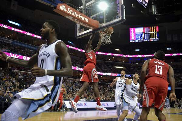 Houston Rockets center Clint Capela dunks against Memphis Grizzlies forward JaMychal Green (0), center Marc Gasol (33) and forward Dillon Brooks (24) as Rockets guard James Harden (13) watches during the first half of an NBA basketball game Saturday, Nov. 18, 2017, in Memphis, Tenn. (AP Photo/Brandon Dill)