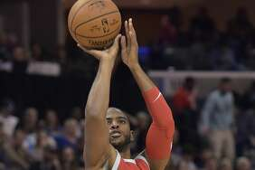 Houston Rockets guard Chris Paul (3) takes a 3-point shot during the first half of an NBA basketball game against the Memphis Grizzlies on Saturday, Nov. 18, 2017, in Memphis, Tenn. (AP Photo/Brandon Dill)