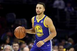 PHILADELPHIA, PA - NOVEMBER 18: Stephen Curry #30 of the Golden State Warriors brings the ball up the floor against the Philadelphia 76ers in the second half at Wells Fargo Center on November 18, 2017 in Philadelphia,Pennsylvania. NOTE TO USER: User expressly acknowledges and agrees that, by downloading and or using this photograph, User is consenting to the terms and conditions of the Getty Images License Agreement. (Photo by Rob Carr/Getty Images)