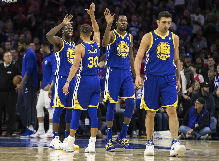 1e0356fe1d1 Golden State Warriors  Stephen Curry (30) high-fives to Kevin Durant