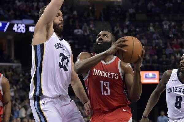 Houston Rockets guard James Harden (13) drives against Memphis Grizzlies center Marc Gasol (33) during the first half of an NBA basketball game Saturday, Nov. 18, 2017, in Memphis, Tenn. (AP Photo/Brandon Dill)