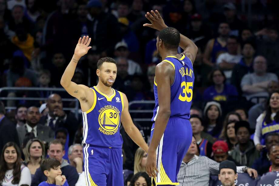 PHILADELPHIA, PA - NOVEMBER 18: Stephen Curry #30 and Kevin Durant #35 of the Golden State Warriors celebrate during the end of the Warriors 124-116 win over the Philadelphia 76ers at Wells Fargo Center on November 18, 2017 in Philadelphia,Pennsylvania. NOTE TO USER: User expressly acknowledges and agrees that, by downloading and or using this photograph, User is consenting to the terms and conditions of the Getty Images License Agreement. (Photo by Rob Carr/Getty Images) Photo: Rob Carr, Getty Images