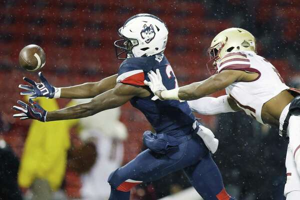UConn wide receiver Tyraiq Beals (2) is unable to make the catch under pressure from Boston College defensive back Lukas Denis on Saturday.