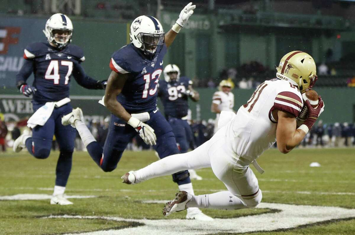 Boston College's Chris Garrison (81) makes a touchdown reception in front of UConn's Vontae Diggs (13) and Santana Sterling (47) on Saturday.