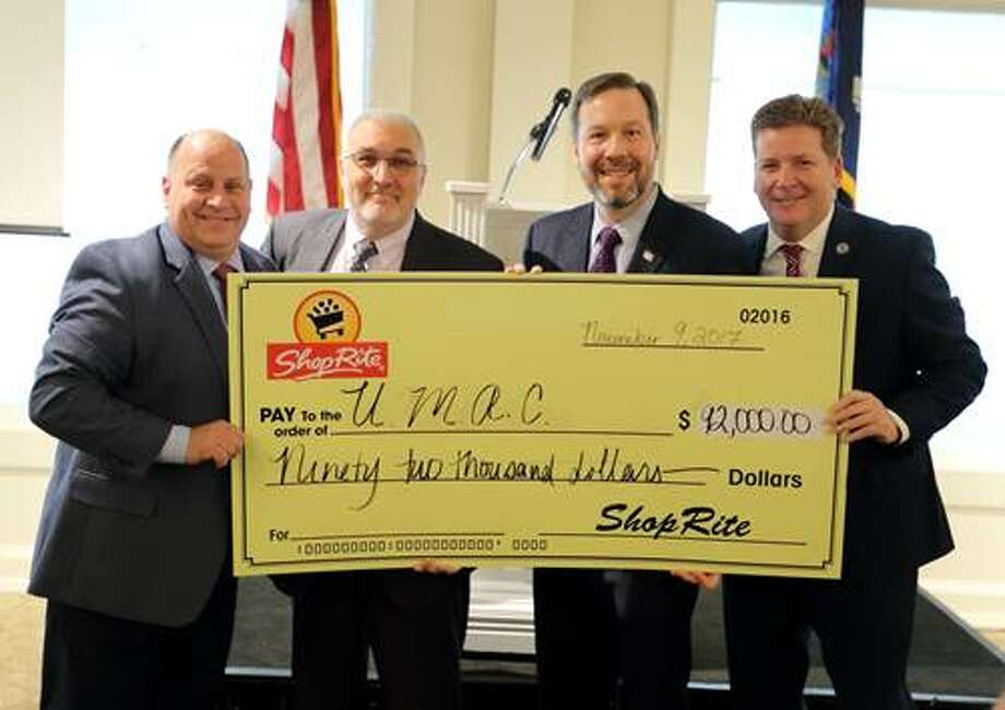 From left, Al Carpenter, district manager, ShopRite Supermarkets, Inc., Ray Gagnon, president, Unified Military Affairs Council, Tom Urtz, vice president of operations, ShopRite Supermarkets, Inc., and Mark Eagan, chief executive officer, Capital Region Chamber. (provided photo)