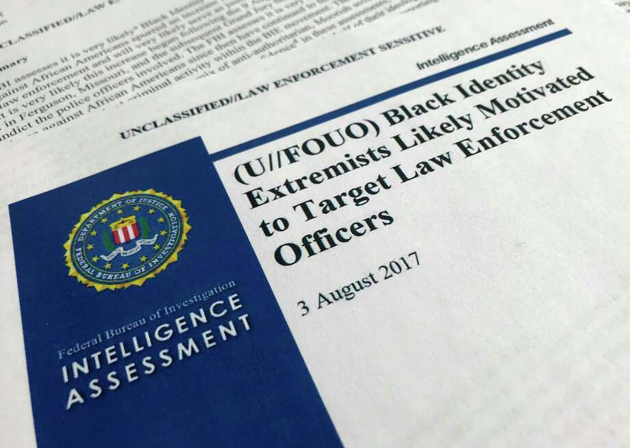 """In this Nov. 17, 2017, photo, the cover page of a FBI report on the rise of black """"extremists"""" is photographed in Washington. The report is stirring fears of a return to practices of the Civil Rights era, when the agency notoriously spied on activist groups without evidence they had broken any laws. Attorney General Jeff Sessions, a former Alabama senator whose career has been dogged by questions about race and his commitment to civil rights, did not ease lawmakers' concerns when he was unable to answer questions about the report or its origins during a congressional hearing on Nov. 14. (AP Photo/Jon Elswick) ORG XMIT: WX103 Photo: Jon Elswick / AP"""