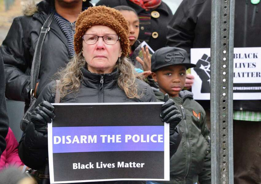Lisa Pelcher of Troy participates in a rally to draw attention to the police killing of Edson Thevenin and shooting of Dahmeek McDonald and to call for the use of a civilian review board Saturday Nov. 18, 2017 in Troy, NY. (John Carl D'Annibale / Times Union)