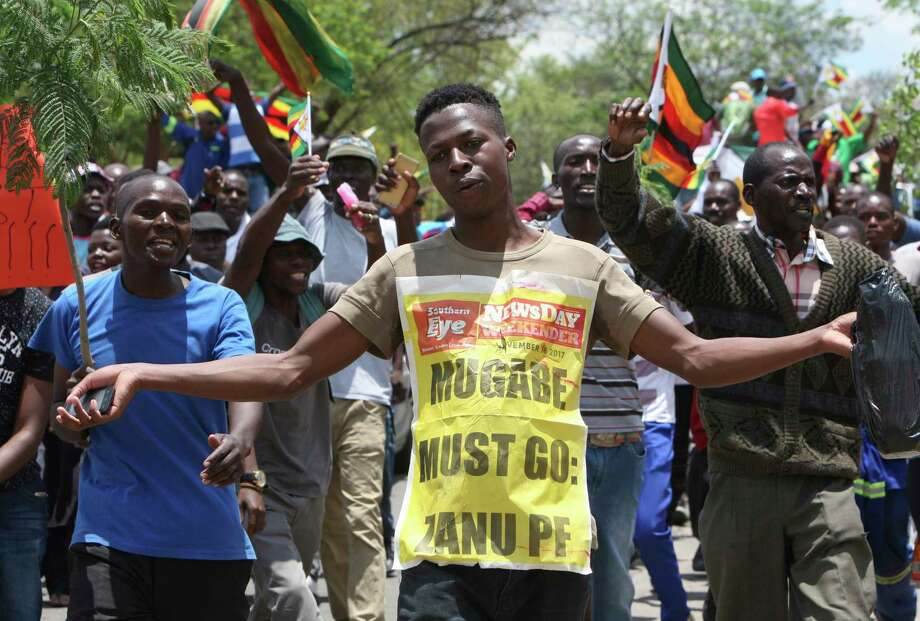 Hundreds gather in Bulawayo, Zimbabwe, Saturday, Nov. 18, 2017 to demand the departure of President Robert Mugabe after nearly four decades in power. (AP Photo/Lucky Tshuma) ORG XMIT: BUL103 Photo: Lucky Tshuma / Copyright 2017 The Associated Press. All rights reserved.