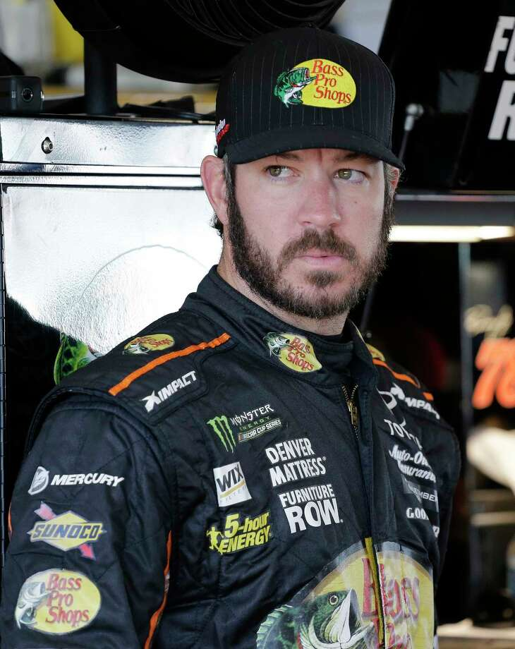 Martin Truex Jr. stands in the garage before practice for a NASCAR Cup Series auto race at Homestead-Miami Speedway in Homestead, Fla., Saturday, Nov. 18, 2017. (AP Photo/Terry Renna) ORG XMIT: FLTR105 Photo: Terry Renna / FR60642 AP