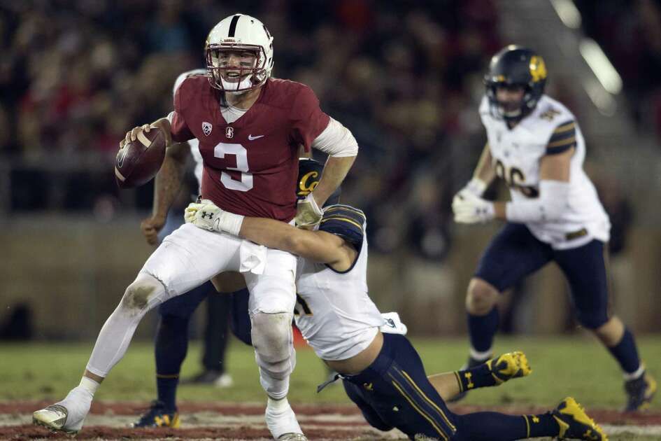 Stanford starting quarterback K.J. Costello (3) is sacked by California's Gerran Brown (41) during the first quarter the 120th Big Game,  Saturday, Nov. 18, 2017 in Stanford, Calif.